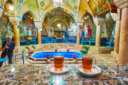 KERMAN, IRAN - OCTOBER 15, 2017: Vakil restaurant in former bath offers relax with a glass of Persian tea, enjoying traditional interior and listening to the ethnic music, on October 15 in Kerman.