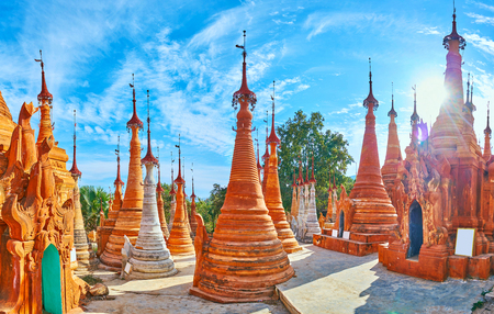 Panorama of ochre pagodas of Nyaung Ohak archaeological site, the famous Buddhist historical complex of Inn Thein (Indein) village on Inle Lake, Myanmar.