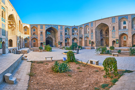 KERMAN, IRAN - OCTOBER 15, 2017: Panorama of Ganjali Khan Caravanserai with Persian tiled patterns above the arches and niches, on October 15 in Kerman