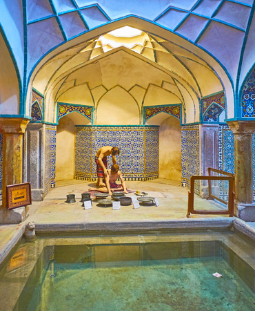 KERMAN, IRAN - OCTOBER 15, 2017: The swimming pool in medieval bathing hall of Ganjali Khan Bathhouse, decorated with patterns on glazed tiles, on October 15 in Kerman.