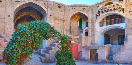 The multi-arched vault and niches of Hindu Caravanserai - the old brick building, located next to the alleyways of Sartasari Bazaar, Kerman, Iran.