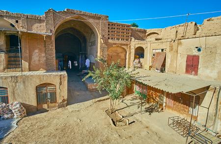 Remains of historical Hindu Caravanserai, nowadays serving as warehouses and workshops for the vendors and artisans, working at Grand Bazaar, Kerman, Iran. Stok Fotoğraf