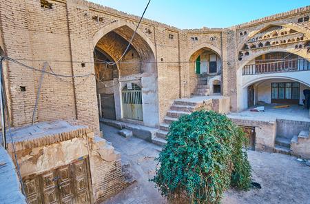 The dusty brick walls and arches of historical Hindu Caravanserai, located in Sartasari Bazaar, Kerman, Iran.