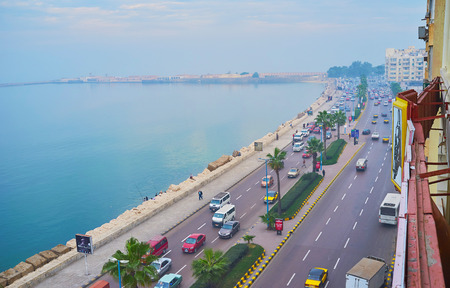 ALEXANDRIA, EGYPT - DECEMBER 18, 2017: The foggy seafront with fast morning traffic, seen from the balcony of edifice, located on first line, on December 18 in Alexandria.