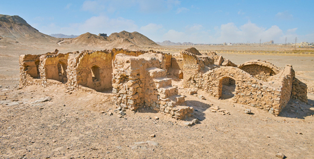 The ancient ruins of Zoroastrian burial complex with ceremonial buildings - Khaiele and Towers of Silence (Dakhma) for burial ritual, Yazd, Iran.