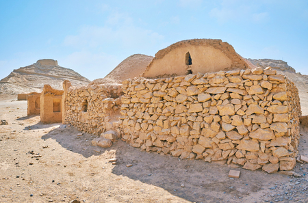 The ancient Khaiele buildings were used for ceremonial needs of Zoroastrian community, that constructed the burial site of Towers of Silence in rocky desert, next to Yazd, Iran. Stock Photo