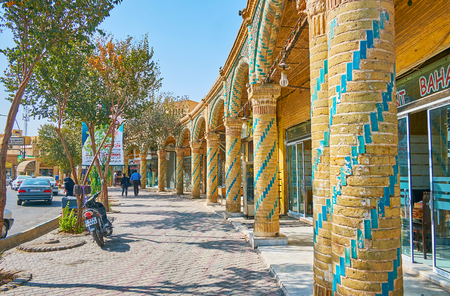 YAZD, IRAN - OCTOBER 18, 2017: The old trading arcades with slender columns and blue tiled patterns surround Shahid Beheshti Square in Old Town, on October 18 in Yazd. Editorial