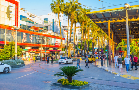 ANTALYA, TURKEY - MAY 11, 2017: Corner of busy Cumhuriyet Avenue and Ataturk Boulevard, regular heavy traffic, people and high trade activity make this place noisy and crowded, on May 11 in Antalya.