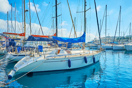 VALLETTA, MALTA - JUNE 17, 2018: The dense rows of moored sailing yachts in marina, on June 17 in Valletta.