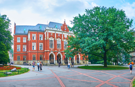 KRAKOW, POLAND - JUNE 11, 2018: The frontage of Collegium Novum, that is the most beautiful and the oldest building of Jagiellonian University, on June 11 in Krakow.