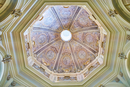 VALLETTA, MALTA - JUNE 17, 2018: Mattia Pretis dome of St Catherine of Italy Church, decorated with painted stucco details in grey colors with gold, on June 17 in Valletta.