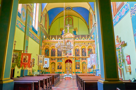 KRAKOW, POLAND - JUNE 11, 2018: Interior of Ukrainian Greek Catholic Church of Exaltation of the Holy Cross with beautiful carved iconostasis, on June 11 in Krakow.
