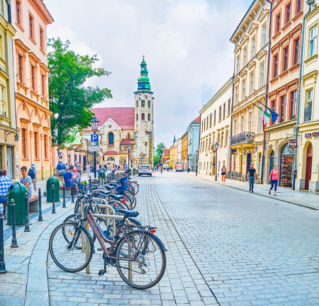 KRAKOW, POLAND - JUNE 11, 2018: Bicycle is one of the most beloved transport among locals, and the only allowed on pedestrian part of the city, on June 11 in Krakow. 에디토리얼