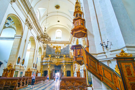 KRAKOW, POLAND - JUNE 11, 2018: Beautiful nave of St Peter and Paul Church with wooden carved pulpit dominates over the seats, on June 11 in Krakow. Editorial