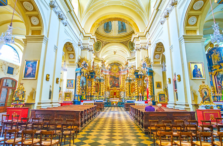 KRAKOW, POLAND - JUNE 11, 2018: Beautiful baroque style interior of St. Bernard of Siena Church with golden iconostasis, on June 11 in Krakow.