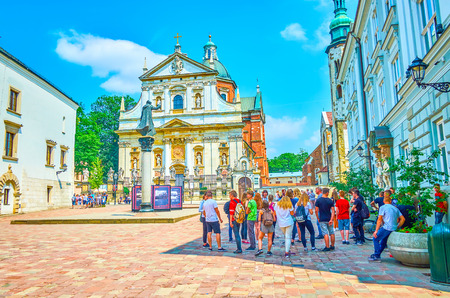 KRAKOW, POLAND - JUNE 11, 2018: The small St. Mary Magdalene Square boasts beautiful surrounding buildings, such as St Peter and Paul Church, the Pontifical University and others, on June 11 in Krakow.