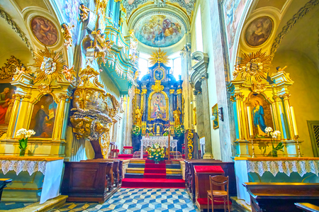 KRAKOW, POLAND - JUNE 11, 2018: Beautiful interior of St Andrew Church decorated with carved plaster, gilden elements and beautiful pulpit, on June 11 in Krakow.