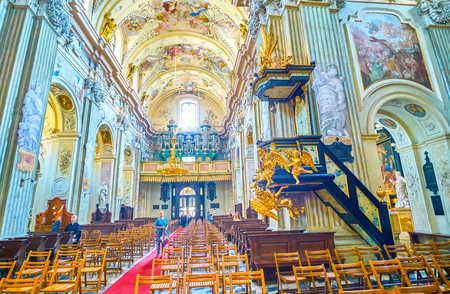 KRAKOW, POLAND - JUNE 11, 2018: The central nave of St Anna Church with beautiful decorated pulpit and pipe organ over the main entrance, on June 11 in Krakow.2 Editorial