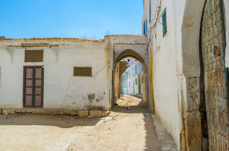 The old street of Medina with historical residential houses, waiting for restoration, Kairouan, Tunisia.