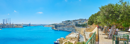 The Lower Barrakka Gardens boasts one of the best city viewpoints, opening the view on the Grand Harbour and medieval fortified cities, Valletta, Malta. Stock Photo
