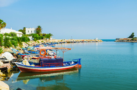 The line of the colored wooden fishing boats in ancient Punic port, Carthage, Tunisia.
