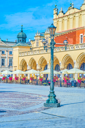 KRAKOW, POLAND - JUNE 11, 2018: The main sqaure of Krakow boasts beautiful vintage styled lanterns, that well harmonize with surrounding architecture, on June 11 in Krakow. Editorial