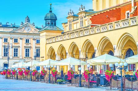 The summer terrace of one of historical restaurants adjoining to Sukiennice of Krakow, Poland Фото со стока