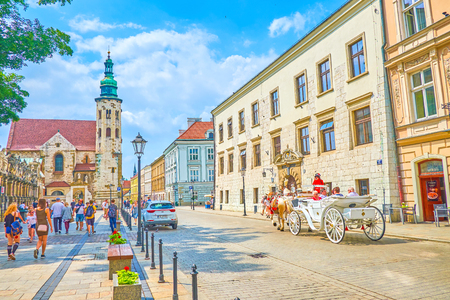 KRAKOW, POLAND - JUNE 11, 2018: Grodzska  is the most famous tourist street in the city, with high number of historical landmarks on it, on June 11 in Krakow. Redactioneel