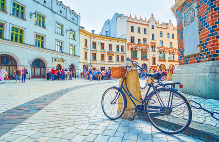 KRAKOW, POLAND - JUNE 11, 2018: The old bicycle parket at the corner of St Mary Basilica, on Plac Mariacki Square, on June 11 in Krakow.