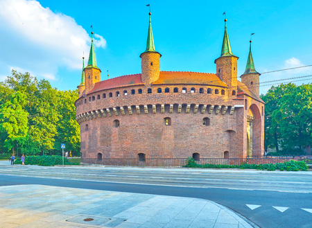Barbakan is one of the most notable landmark of Krakow, located among lush greenery of city park, Poland Editöryel