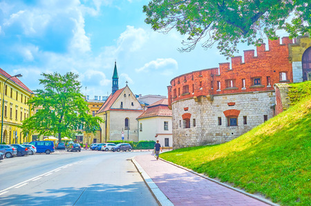 The medieval neighborhood of Krakow lies on the foot of Wawel Castle hill, Poland