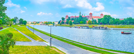 Vistula River boasts wide promenade areas on its both banks for lazy walks overlooking the medieval architecture of Krakow, Poland