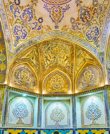 KASHAN, IRAN - OCTOBER 22, 2017: The rich Persian patterns of carved plaster and bright paint in sarbineh of Sultan Amir Ahmad (Qasemi) Bathhouse, on October 22 in Kashan.