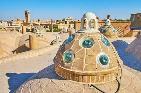 The roofscape of Qasemi (Sultan Amir Ahmad) Bathhouse with convex glass pieces in old brick domes to provide the daylight to the halls and chambers of hammam, in Kashan, Iran. Éditoriale