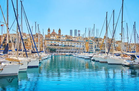 The view on the old town of Senglea from Vittoriosa marina with two lines of yachts on the both sides, Malta.