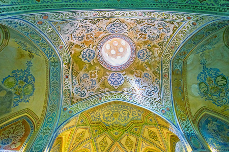 KASHAN, IRAN - OCTOBER 22, 2017: The medieval vault in Qasemi (Sultan Amir Ahmad) Bathhouse, the rich floral plaster patterns are covered in different colors, on October 22 in Kashan.
