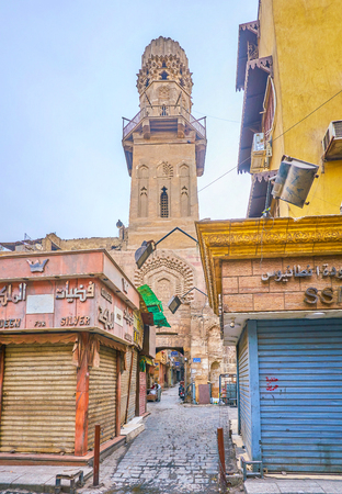 CAIRO, EGYPT - DECEMBER 23, 2017: The high minaret of Madrasa of al-Salih Najm al-Din Ayyub is a pearl of medieval Islamic architecture in Cairo, on December 23 in Cairo