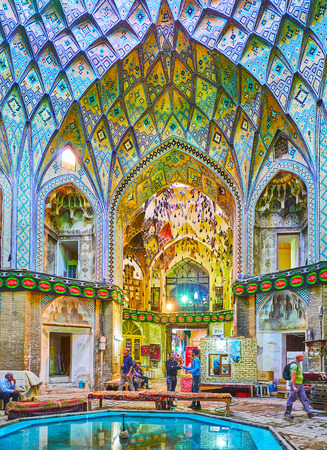KASHAN, IRAN - OCTOBER 22, 2017: The scenic vault of Aminoddole Caravanserai (Timche-ye Amin od-Dowleh) with muqarnas arches, covered with colorful tiled patterns, on October 22 in Kashan. Editorial