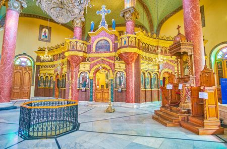 CAIRO, EGYPT - DECEMBER 23, 2017: The beautiful interior of St George Church with stone iconostasis with built-in icons, on December 23 in Cairo Editorial