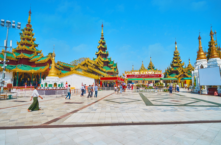 YANGON, MYANMAR - FEBRUARY 27, 2018: Area of Victory Ground with a view on King Singu's Min Bell, Chanthargyi Buddha Image House and Hall of Great Prosperity on background, Shwedagon, on February 27 in Yangon Editoriali