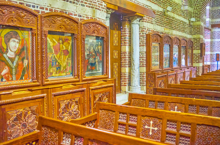CAIRO, EGYPT - DECEMBER 23, 2017: The beautiful ancient Byzantine style icons in the prayer hall of St Barbara Church, on December 23 in Cairo. Editorial