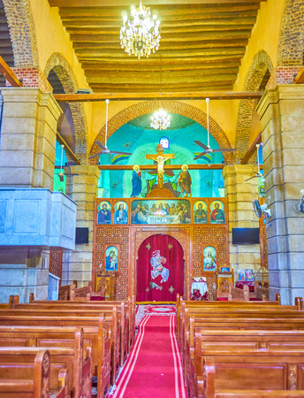 CAIRO, EGYPT - DECEMBER 23, 2017: The carved wooden sanctuary screen in St George Church with ivory inlays and row of icons on the top is the most common in Coptic churches, on December 23 in Cairo.