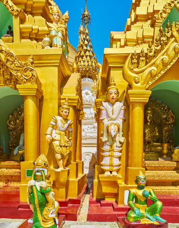 The Nat Spirits and different mythic creatures, like leogryphs (chinthe), serpents (nagar), belu and manote thiha guard the stupas in Shwedagon Pagoda grounds, Yangon, Myanmar.