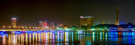 CAIRO, EGYPT - DECEMBER 23, 2017: The best view on modern district of Cairo opens at night, when building illumination reflects from the surface of Nile river, on December 23 in Cairo