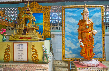 YANGON, MYANMAR - FEBRUARY 27, 2018: The ornate sculpture of Nat (spirit) and the replica of the image house in Ngar Htat Gyi Buddha (Nga Htat Kyee) Temple, on February 27 in Yangon.