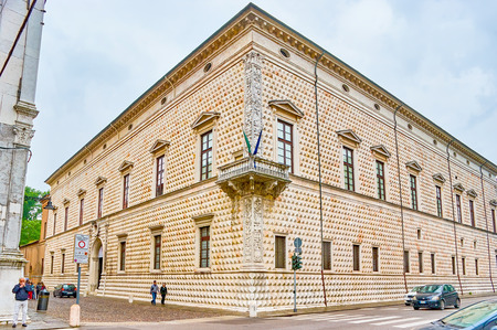 FERRARA, ITALY - APRIL 30, 2013: The Diamond Palace is one of the most unusual buildings in the city with marble rustic decoration of its walls, on April 30 in Ferrara