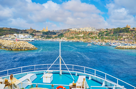The ro-ro ferry arrives to the Mgarr harbour of Ghajnsielem town on Gozo Island, Malta.