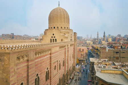CAIRO, EGYPT - DECEMBER 21, 2017: Bab Zuwayla gate is nice viewpoint to observe Sultan al-Muayyad mosque, Al Muizz street with historic mansions and market stalls, on December 21 in Cairo. Sajtókép