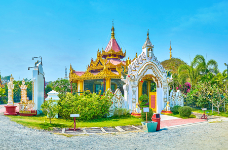 The small decorated pavilion with sculptures of King Mindon surrounded with small garden, Mandalay, Myanmar Editorial