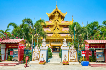 MANDALAY, MYANMAR - FEBRUARY 23, 2018: The beautiful edifice of entrance gallery of Kyauktawgyi Pagoda with rich decorations and pyatthat roof, on February 23 in Mandalay Editorial